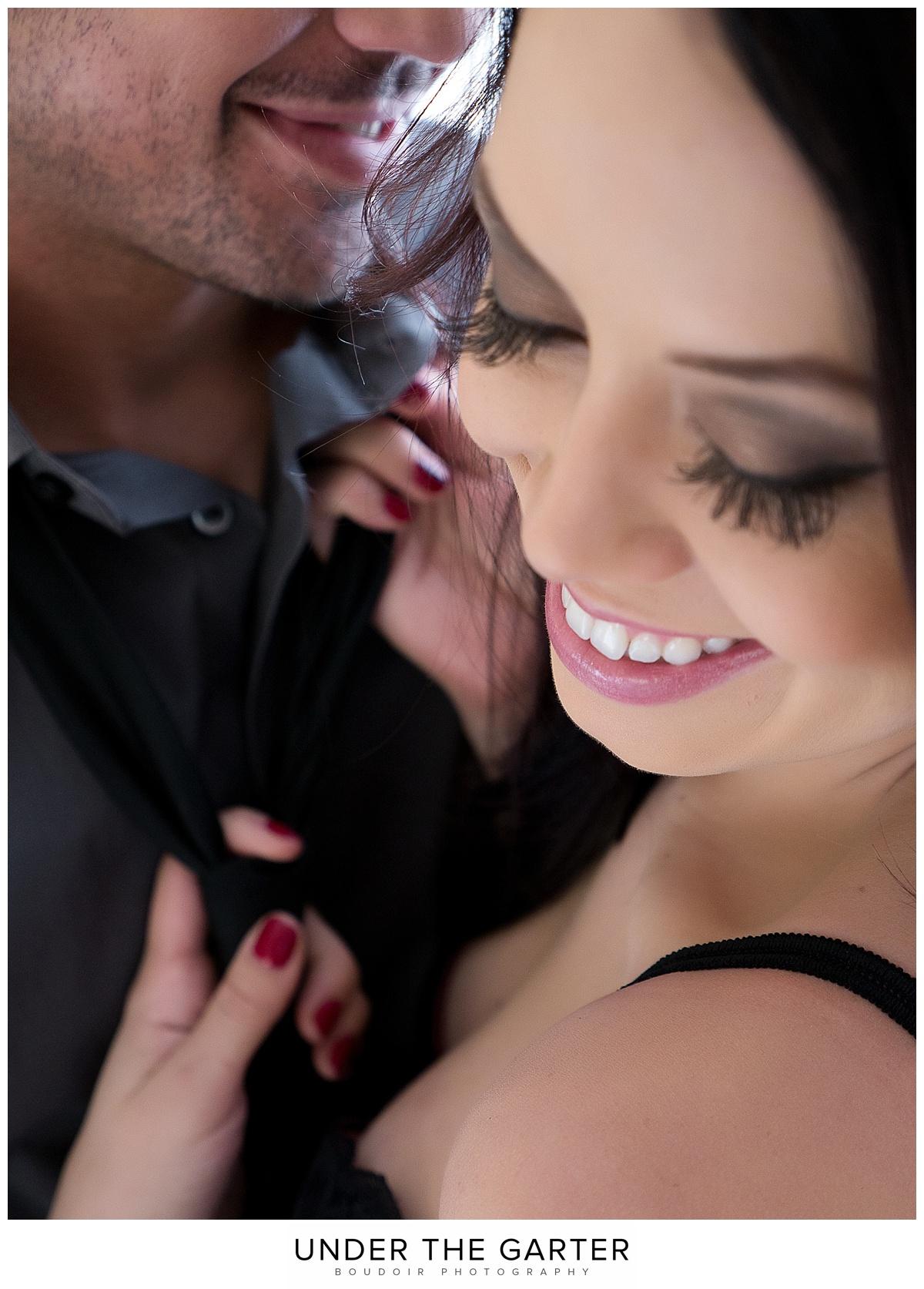 couples boudoir photography denver tie laughing.jpg