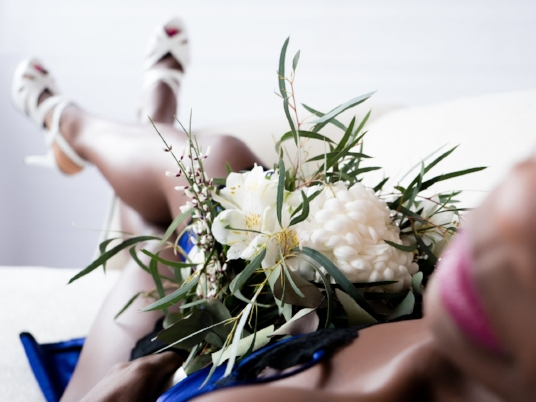 Boudoir-Photo-Denver-Bride-in-Blue-Dress-Reclined-with-Bouquet