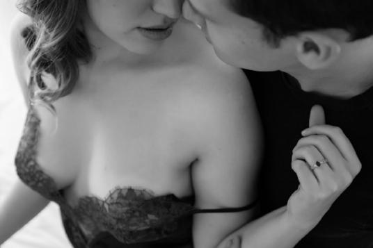 Boudoir Portrait of Man Kissing Woman in Lace Lingerie