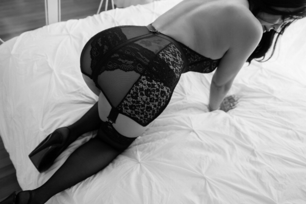 Woman on Bed in Black Lingerie Crawling.jpg