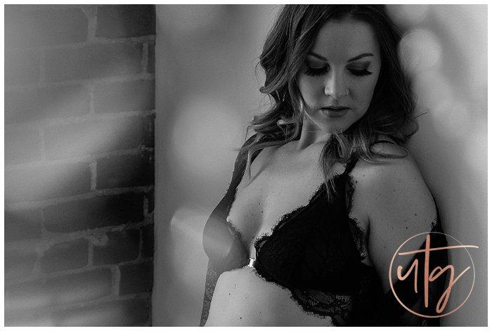 boudoir photography denver chandelier wall pose.jpg