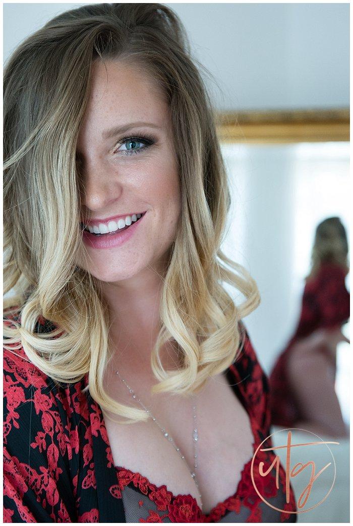 boudoir photography denver green eyes smile red lace.jpg