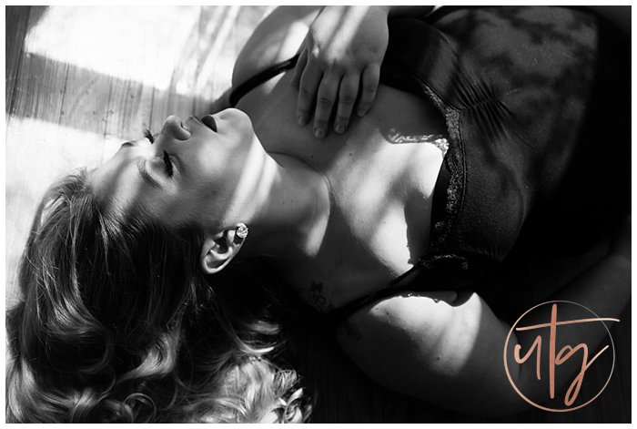 boudoir photography denver shadows floor pose.jpg
