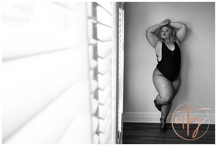 boudoir photography denver bodysuit fishnets wall pose.jpg