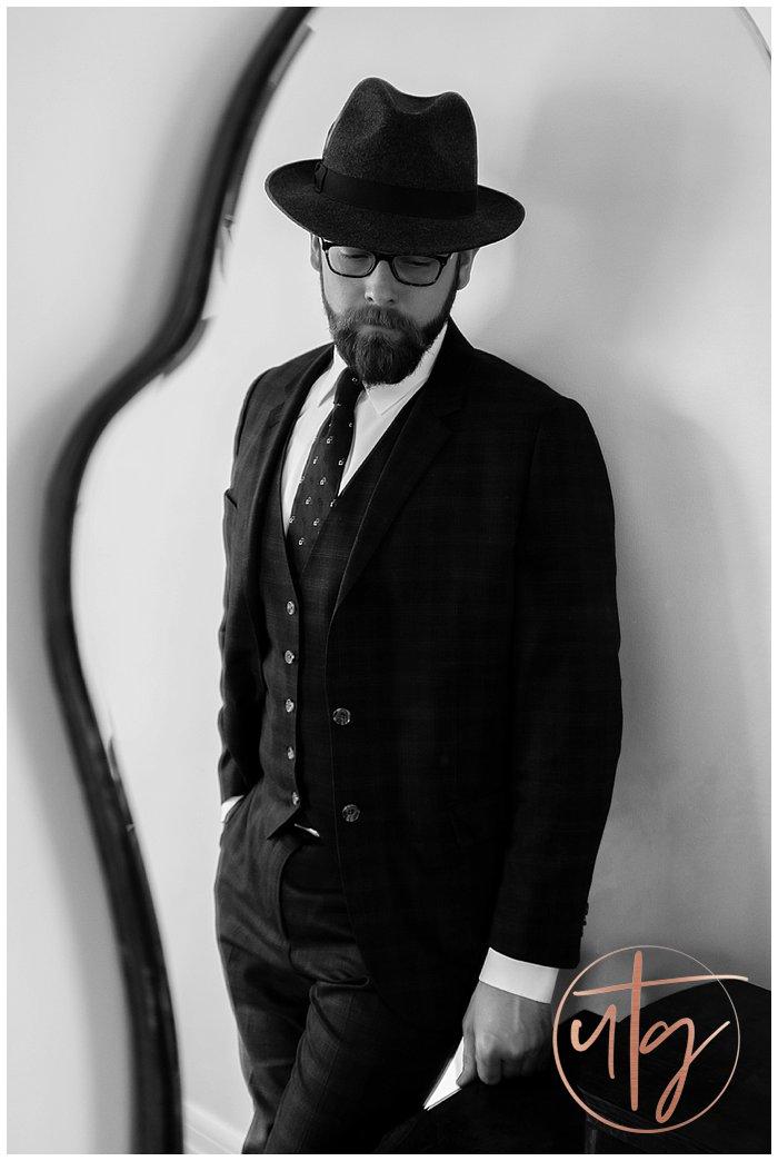 male boudoir photography denver dudoir suit mirror reflection.jpg