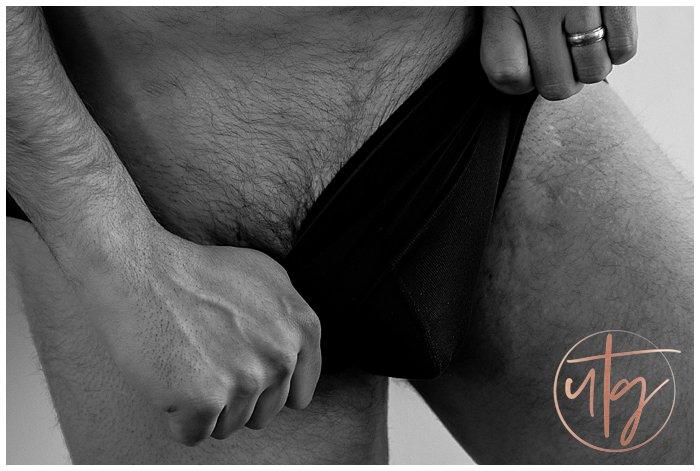 male boudoir photography denver dudoir pulling underwear.jpg