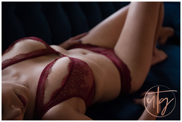 boudoir photography denver blue velvet couch red lace bra.jpg