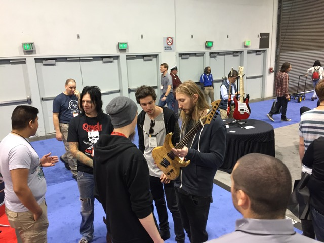Perry chatting with Keith Merrow, Ola Englund, and Plini.