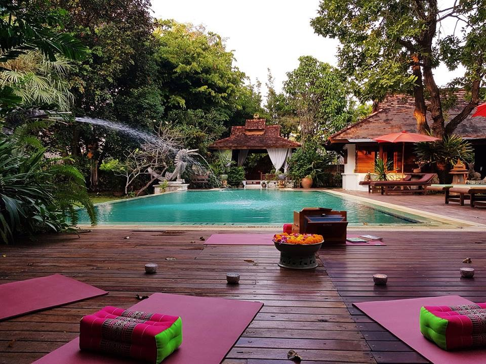 Yoga pool side in a serene environment