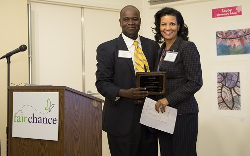 Horizons Greater Washington Board Chair Brenda Jews accepts the plaque from Reggie Grant, Fair Chance Training and Capacity Building Specialist.
