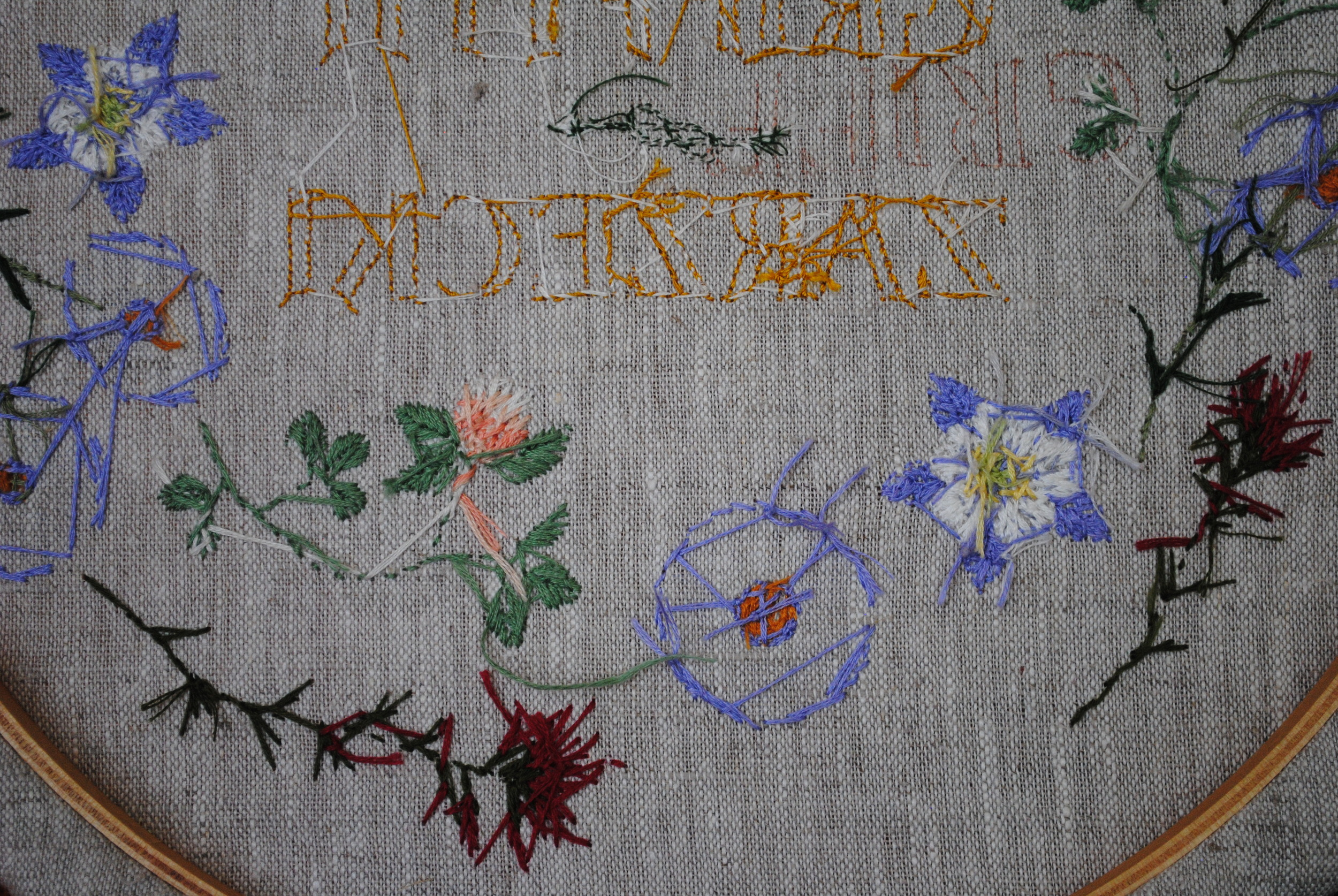 The back of the finished work.  I paid more attention to thread conservation as I went along.