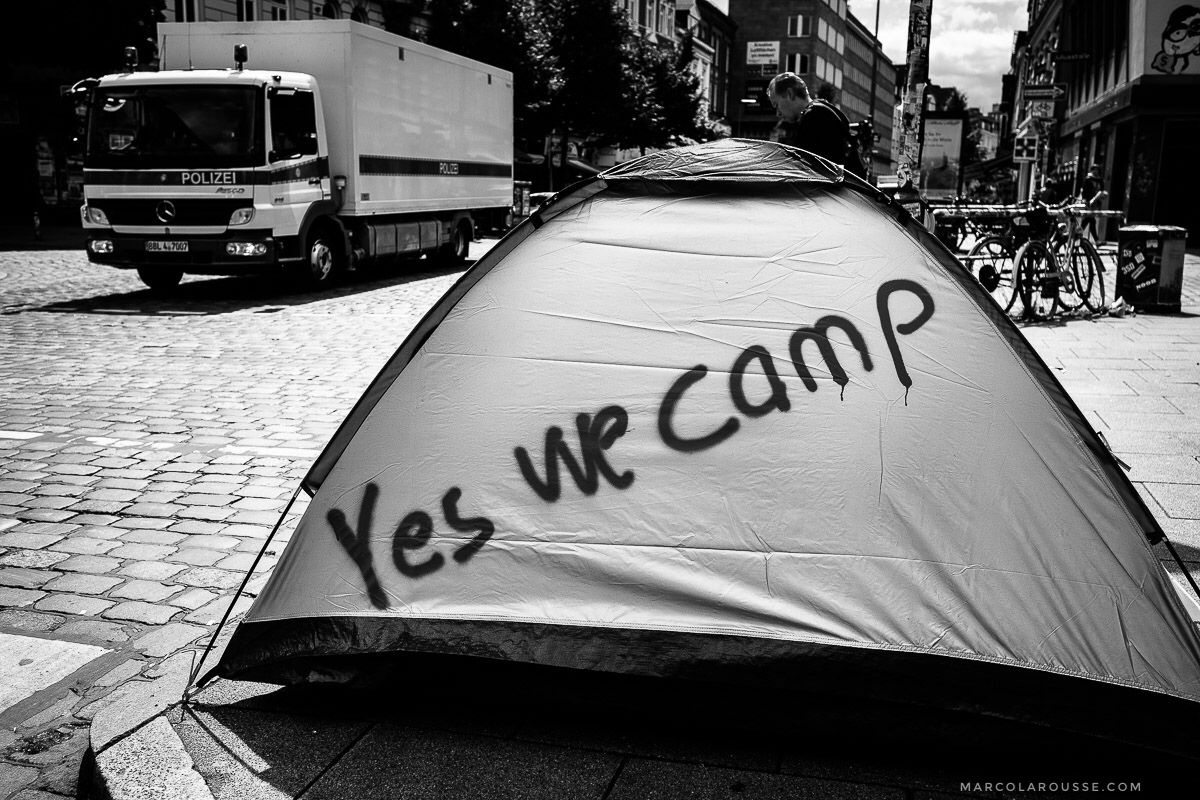 "The Hamburg police had been fighting legal battles with protest organizers who wanted out of town protesters to sleep in a protest camp. ""Yes we camp"" is their slogan to protest the camp ban."