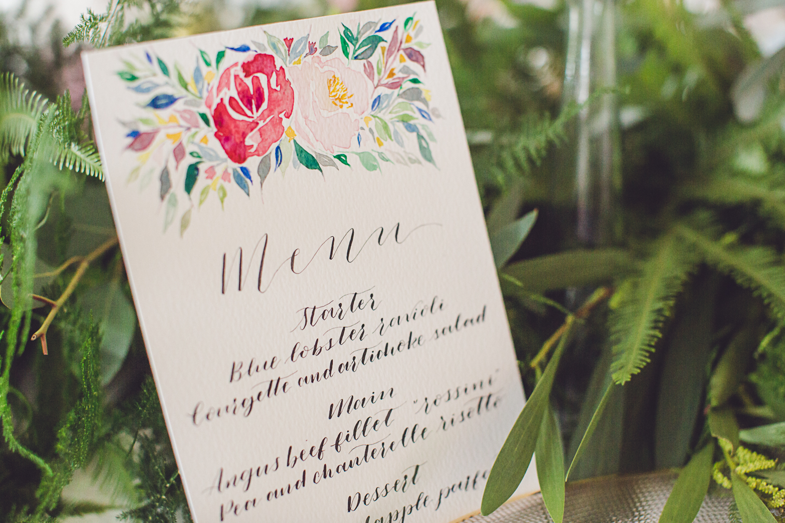 Hand painted watercolour stationery finishes off the table décor perfectly