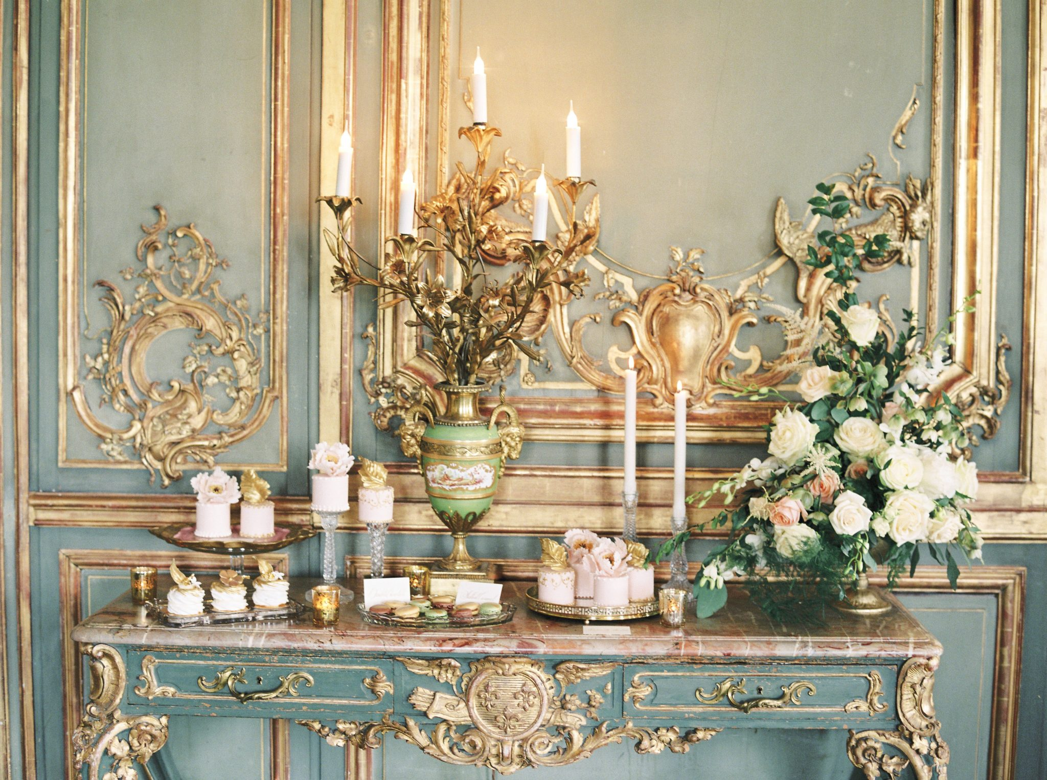 Decadent duck egg and gold is the perfect backdrop for this delicate dessert table. Cakes by Krishanthi.