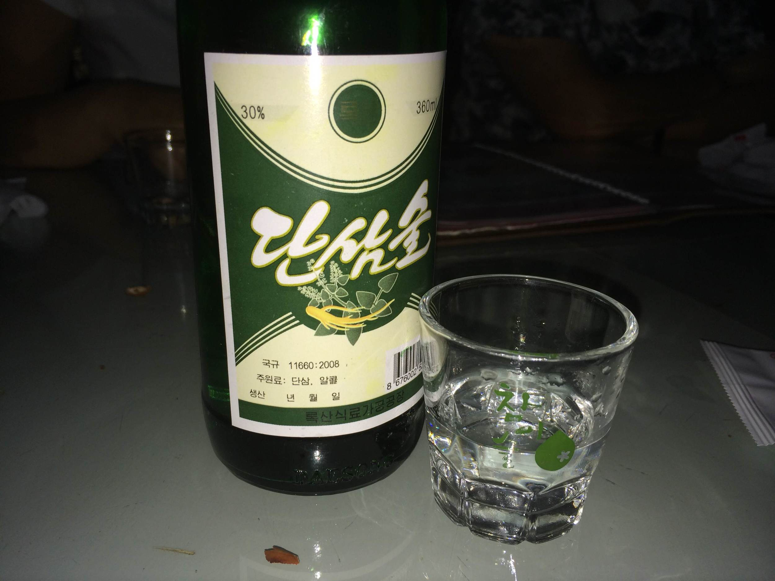 Shot taken by Geoffrey (multiple meanings intended). Stopped for dinner at the highway back to Hanoi. North Koreans pulled out NK soju, Vietnamese waitress pulls out South Korea soju cups. Sojunification!