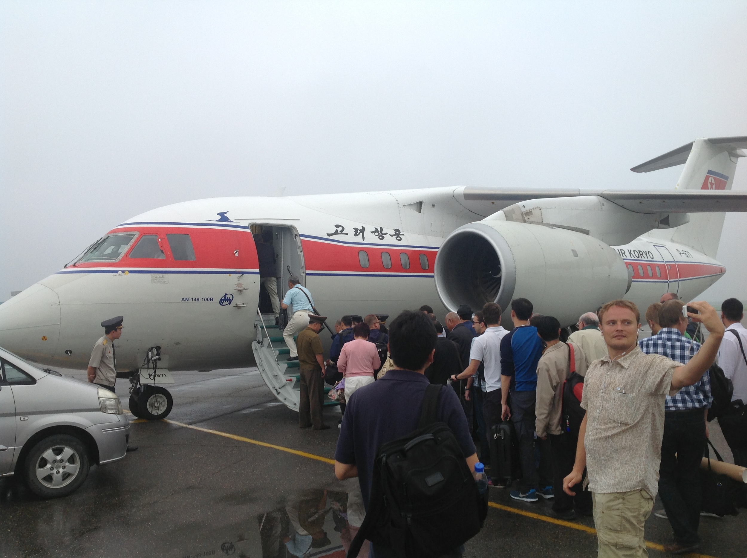 A Russian-made Antonov AN-148 on the tarmac at Sunan International Airport on a rainy day