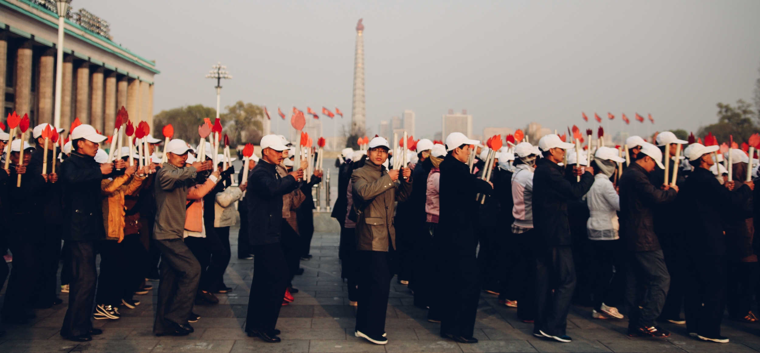 Practicing in Kim Il Sung Square for a torch parade.  Photo by Joe Han