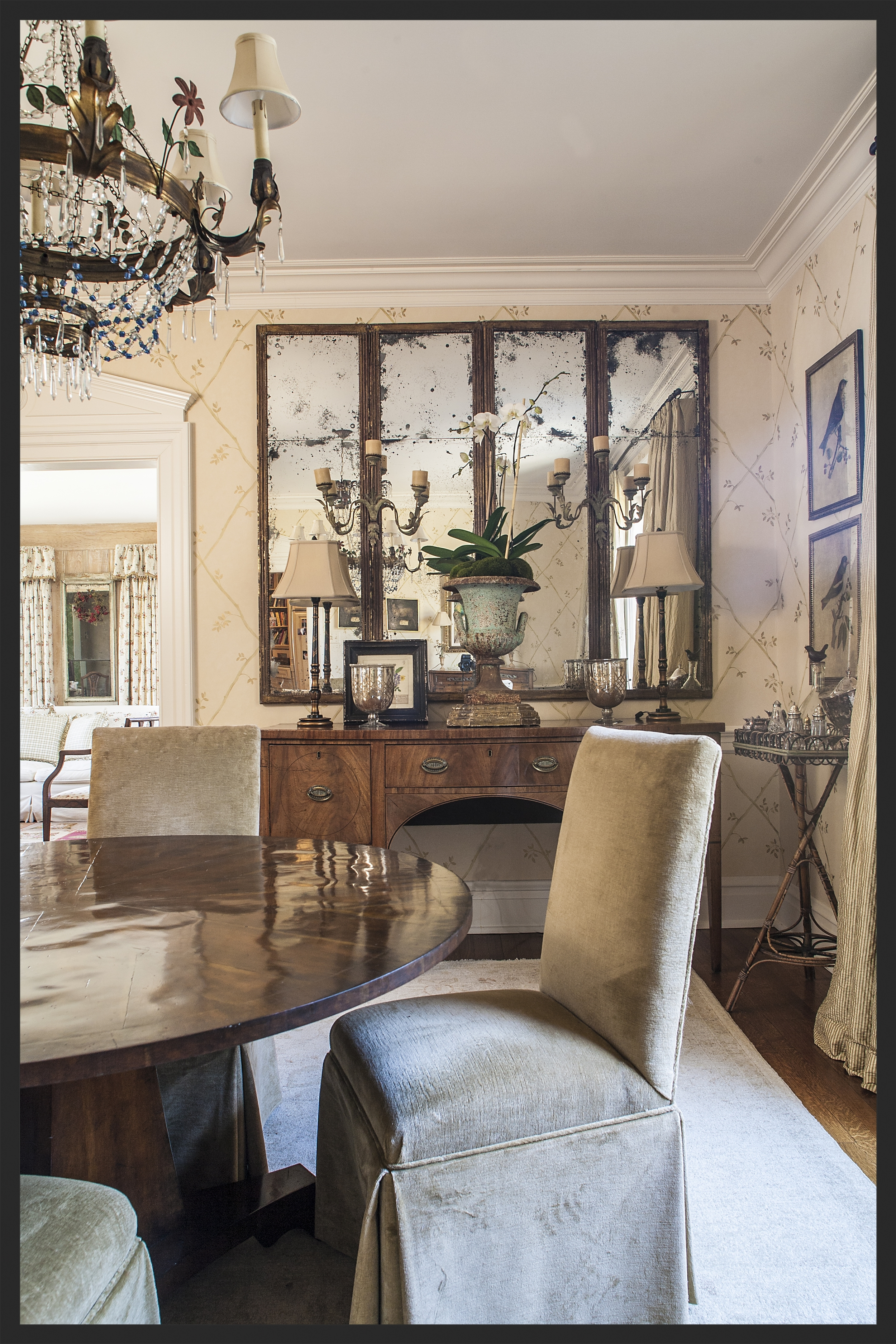 Beautiful English Mahogany sideboard.  Folding mirrored screen hangs above the buffet.  Linda Kay McCloy - alittleenglishinteriors.com