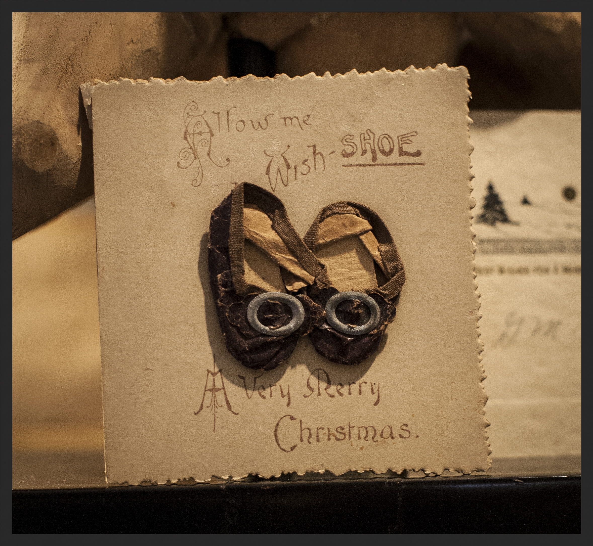 Christmas card from early part of 20th. century.  Tiny leather shoes.  Linda Kay McCloy - alittleenglishinteriors.com