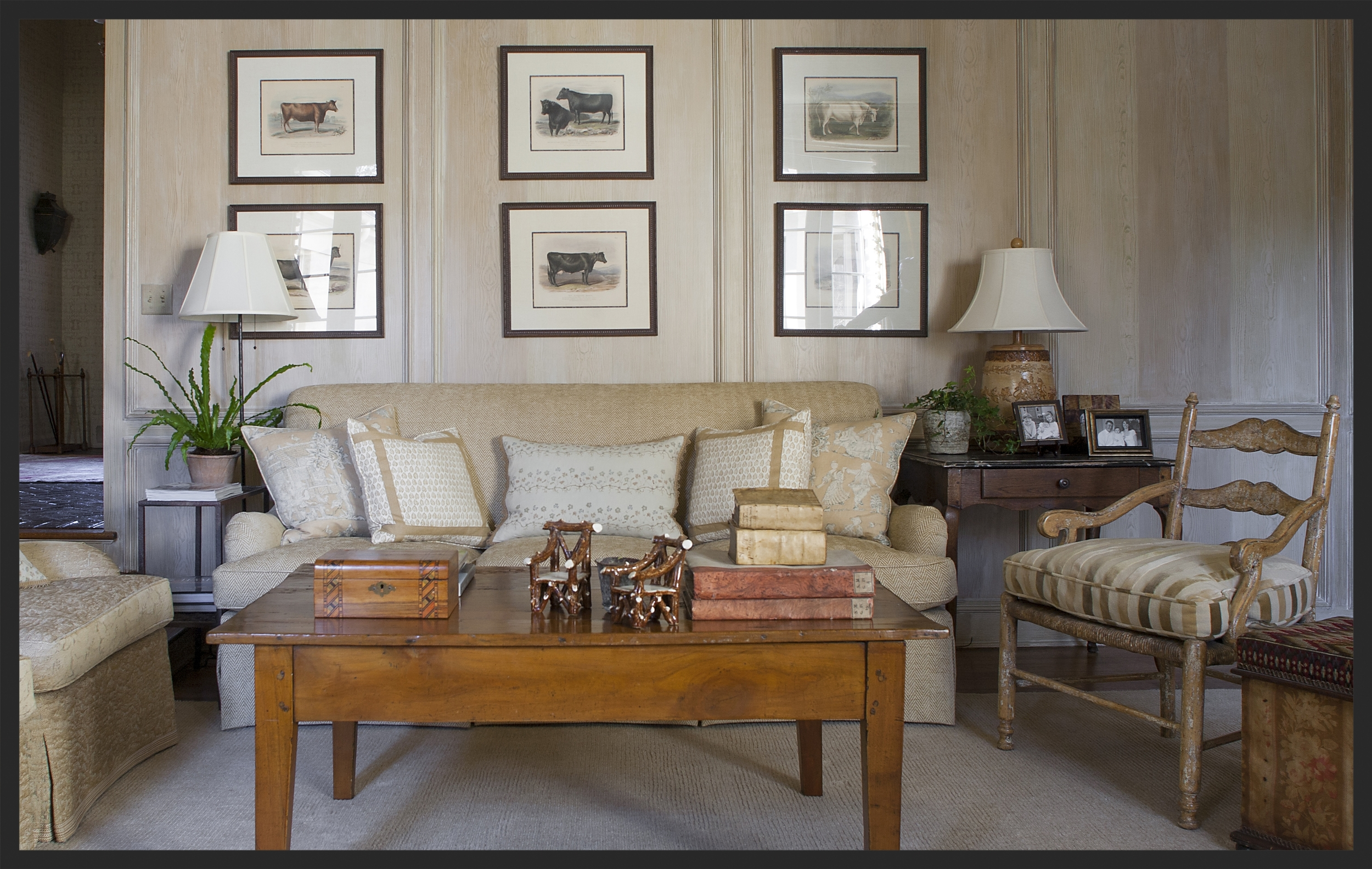 Comfortable family room. Notice the pair of little whimsy Scottish chairs on the coffee table.  Linda Kay McCloy - alittleenglishinteriors.com