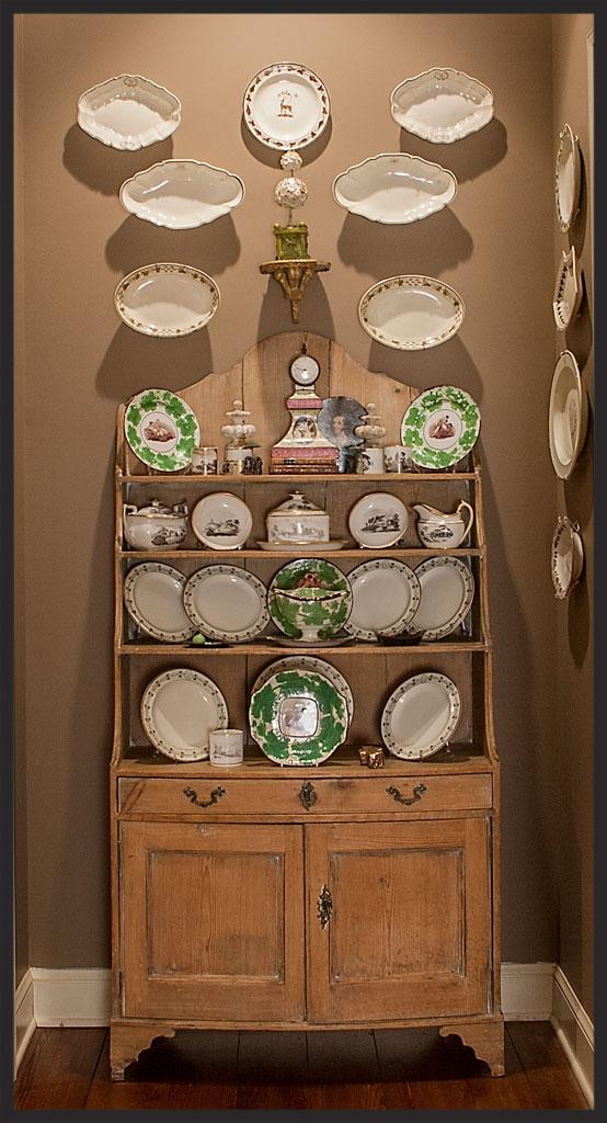 Creamware collection displayed on English Regency pine bookshelf.  Button topiary on small bracket by John Derian.  Linda Kay McCloy - alittleenglishinteriors.com