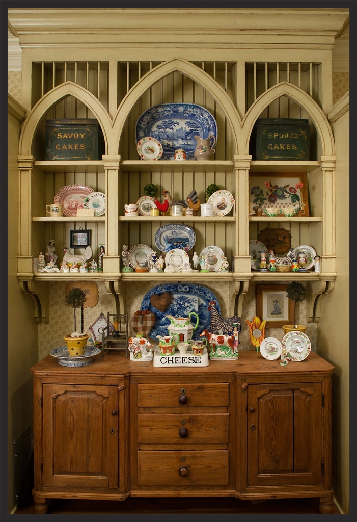 Kitchen cabinet with collection of English Staffordshire, children's plates, and blue and white transferware.  Cabinet design by Menzer-McClure.  Linda Kay McCloy - alittleenglishinteriors.com