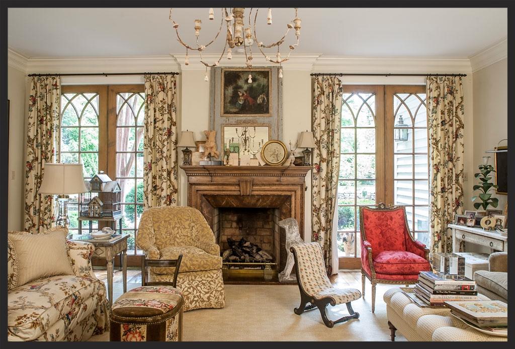 Living room.  Gothic French doors.  Love the red chair!  Linda Kay McCloy - alittleenglishinteriors.com