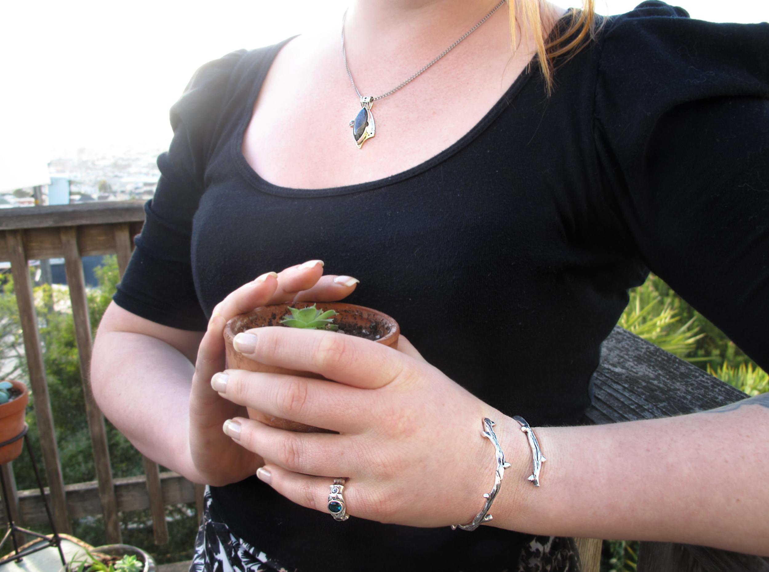 Labradorite Pendant,Ring, and cast sterling silver bracelet.  Model: Hilda Salokorpi  Photo: Nikki Nolan (thenikkinolan.com)
