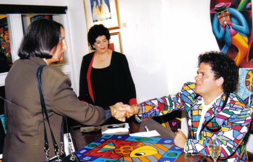 1998-Romero Britto with collectors