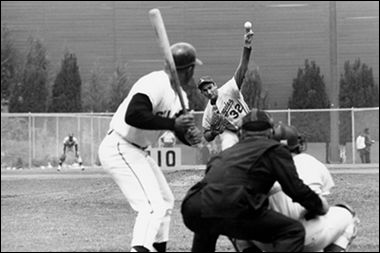 Sandy Koufax pitching to Willie Mays, 1963