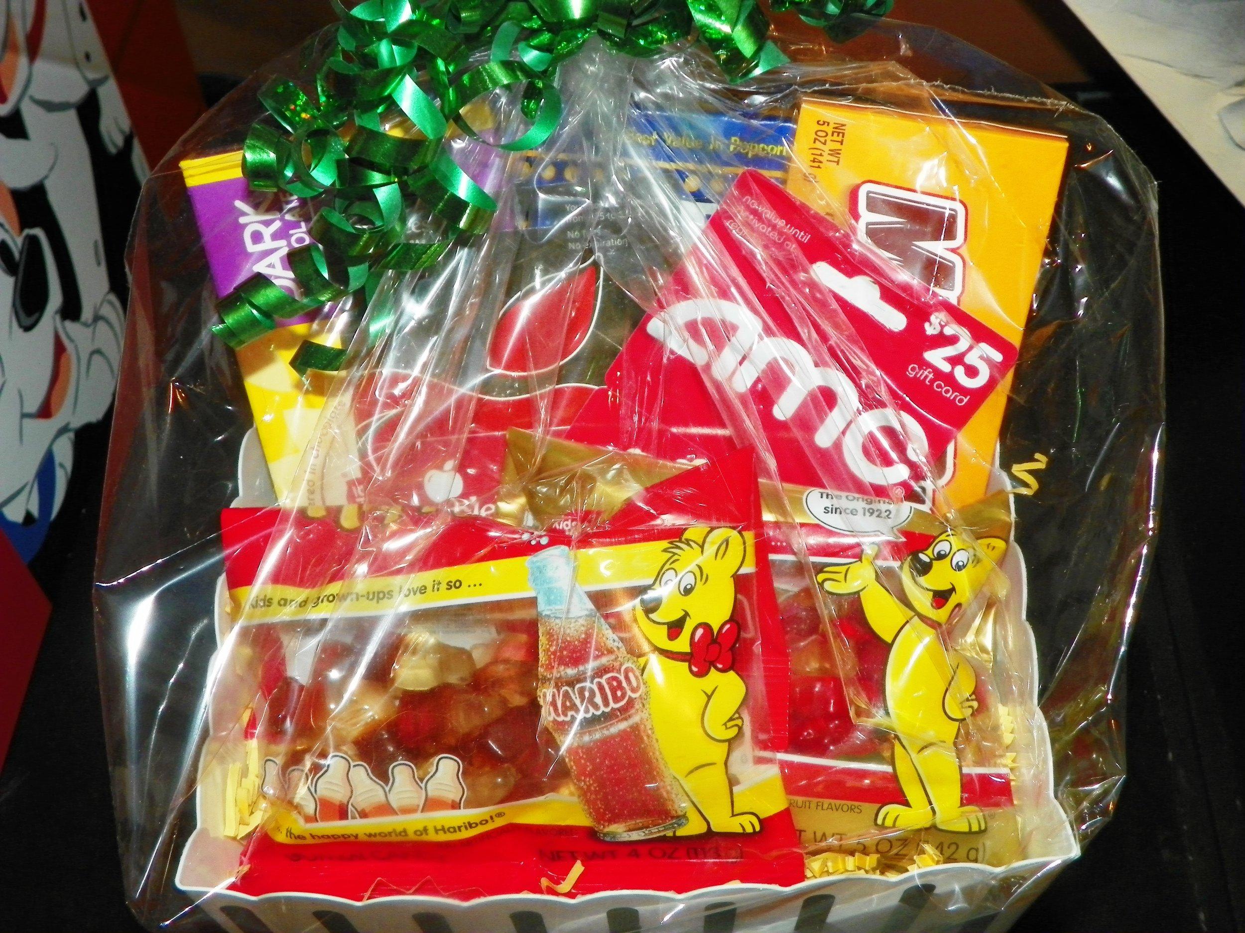 The Popcorn  box -  popcorn, candy, $25.00 AMZ gift card a Applebees Gift card