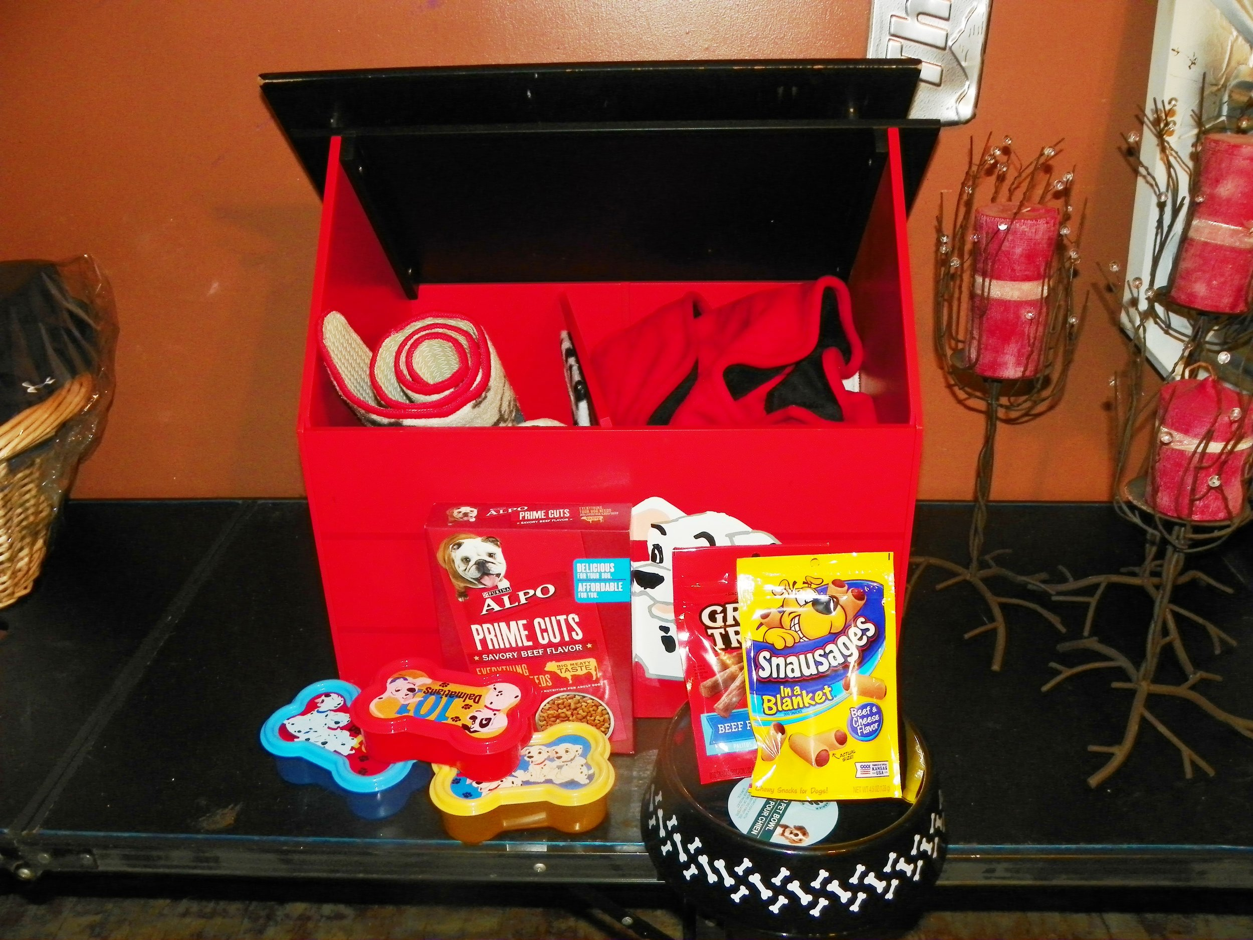 101 Dalmatians dog toy box with dog toys, dog cover, and dog food mat dog bowl. Vale $100.00