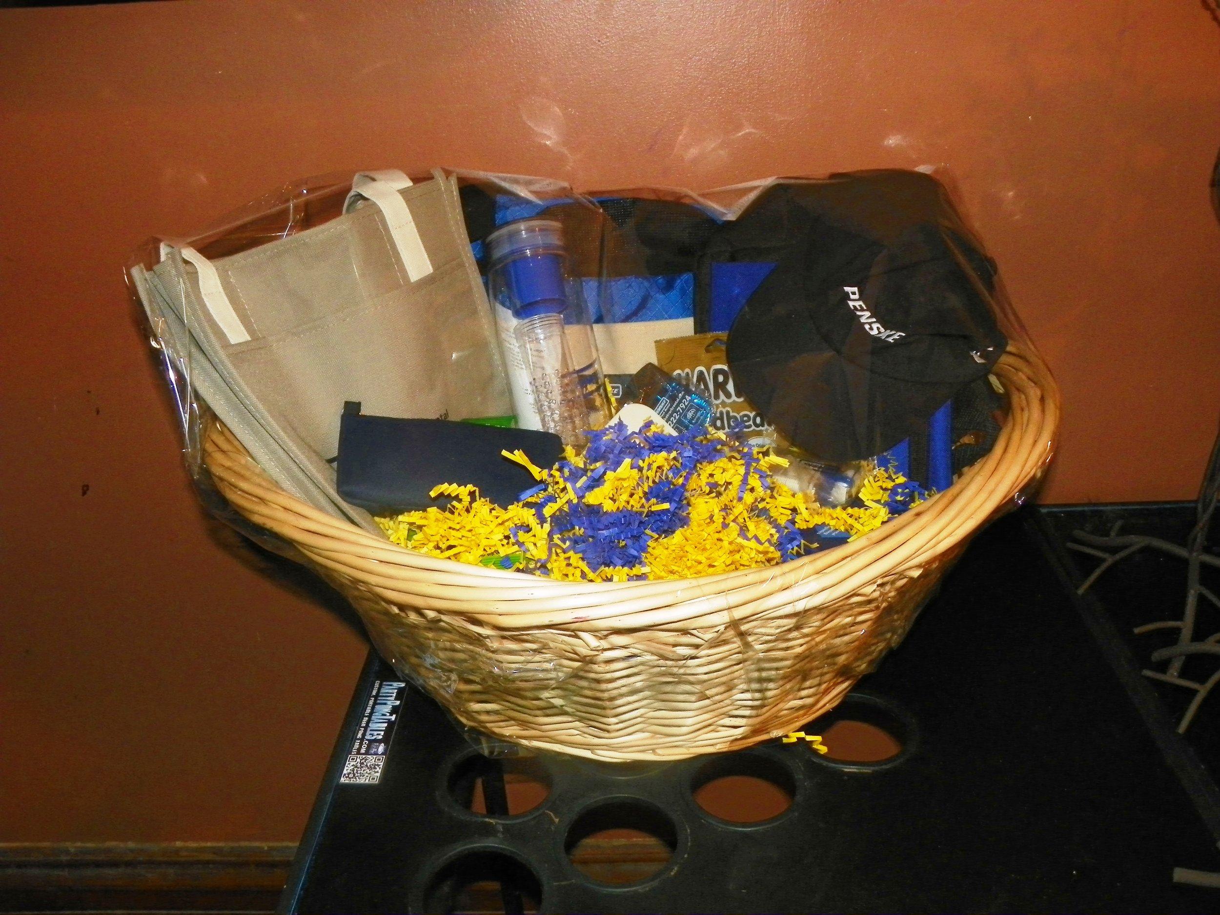 Penski basket - duffel bag, travel pouch, medium tote bag, water bottle, bag clip, fidget spinner, 2 ear buds,bubble lip balm, mints, hand sanitizer, and a phone pouch   - value of $75.00