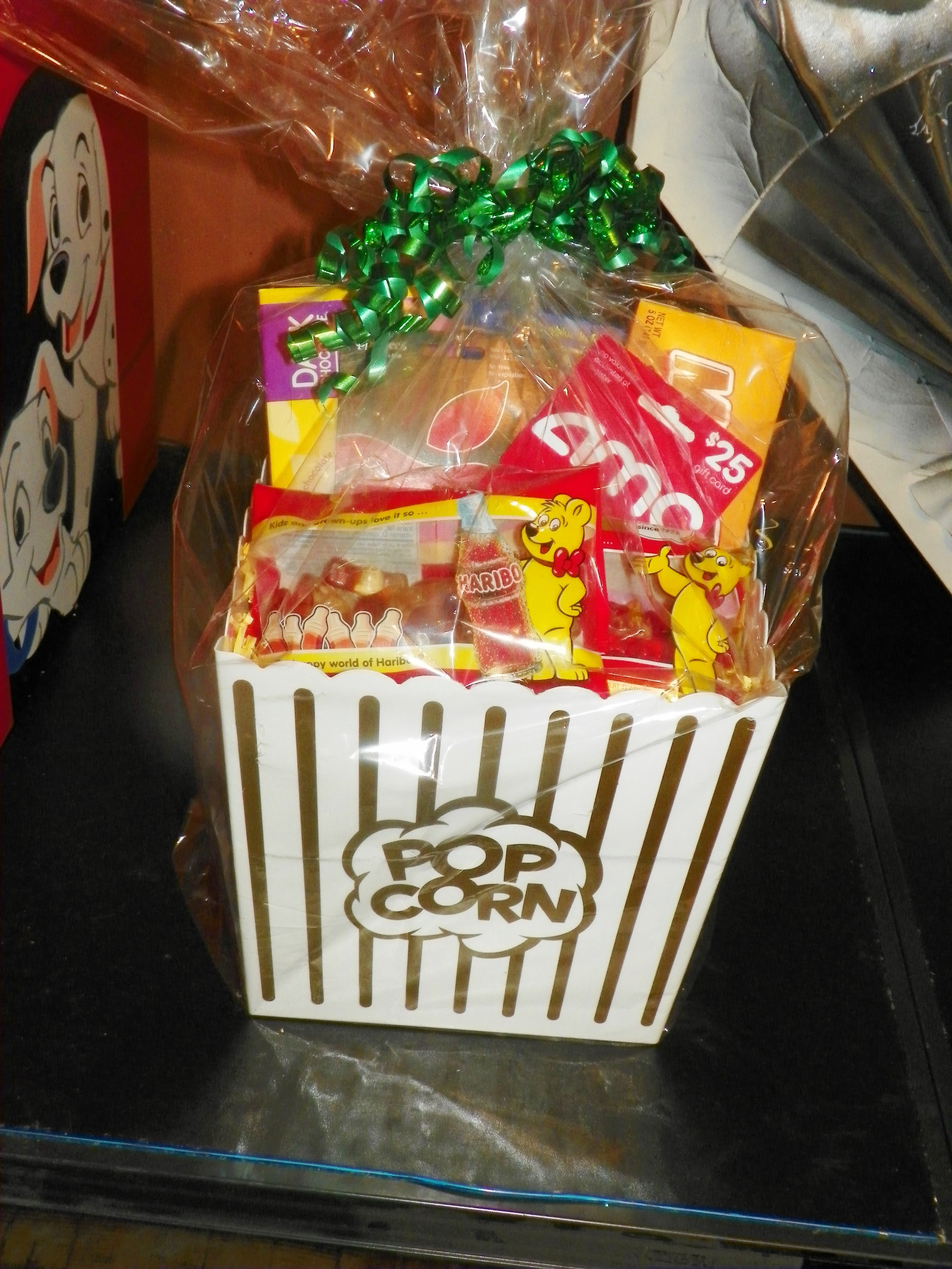 The Popcorn box - popcorn, candy, $25.00 AMZ gift card a Applebees Gift card