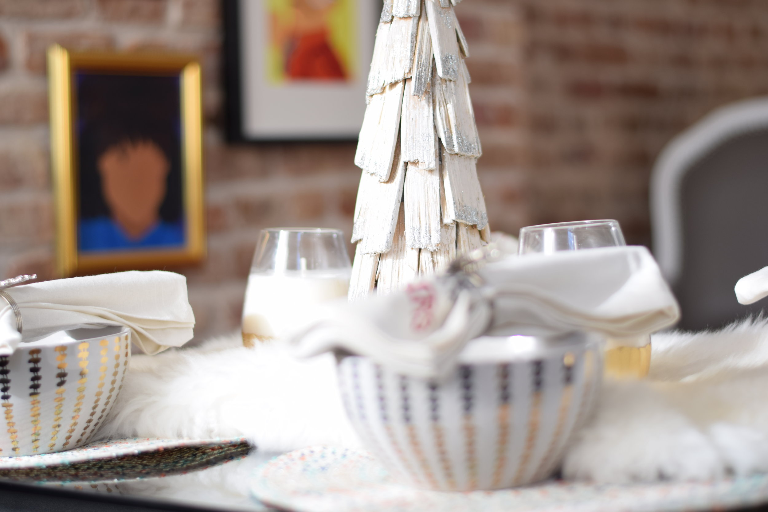 A holiday tree  to makes a rustic centerpiece with a hint of sparkle.