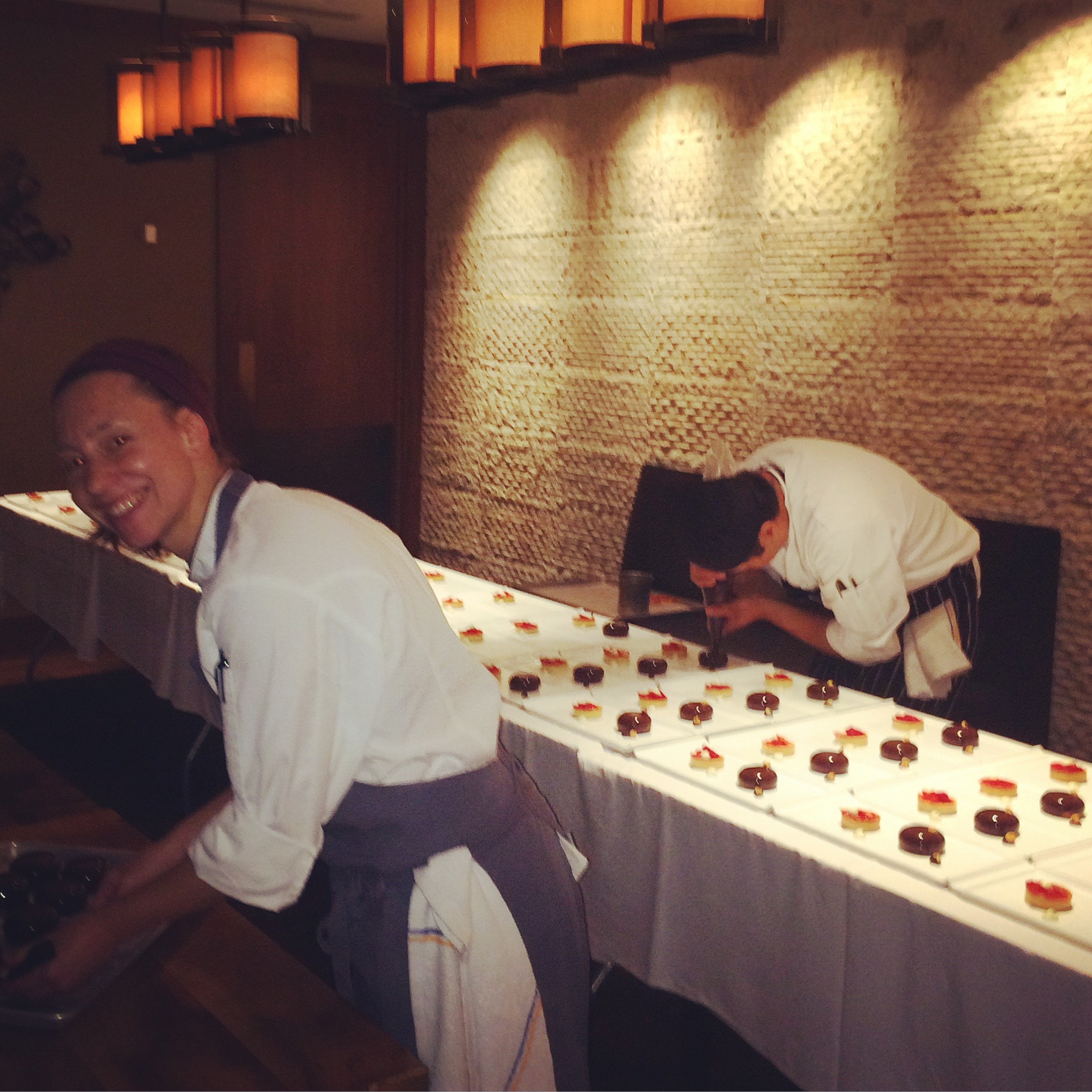 Pastry Chef at Ritz-Carlton plating our desserts