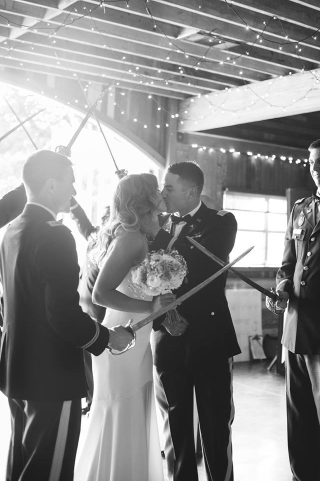 Red Corral Ranch Military Wedding Saber Arch Kiss