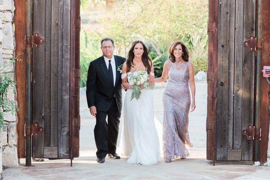 Bride & parents walking down aisle