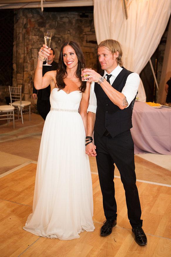 Bride & groom toasting