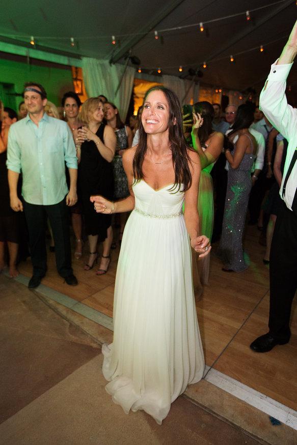 Bride dancing to musician groom performing