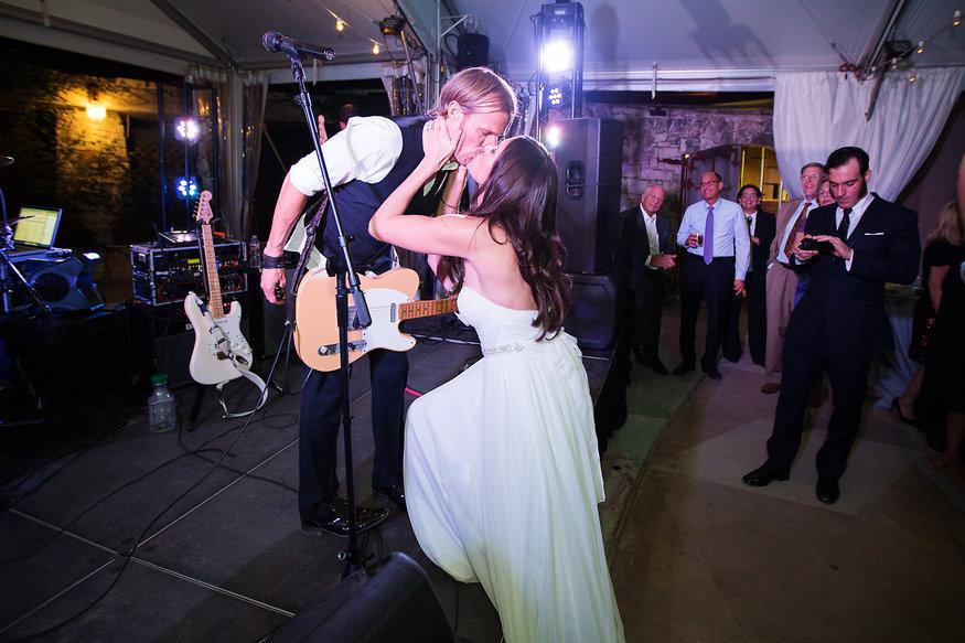 Musician groom kissing bride