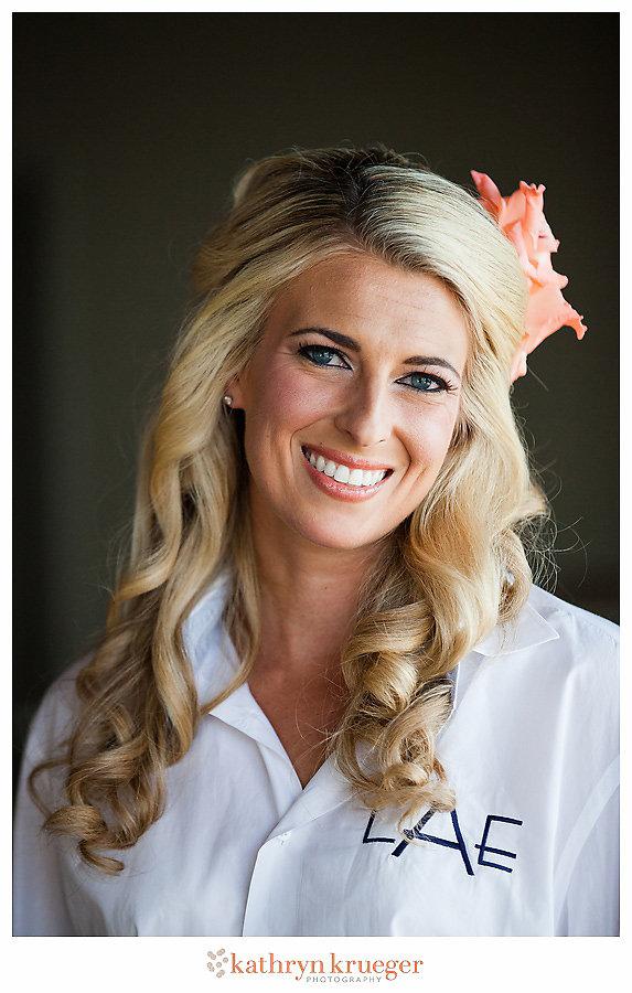 Half-updo bride hairstyle flower in hair monogrammed shirt