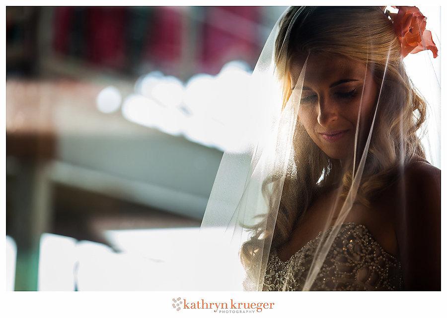 Bride under veil in shadows