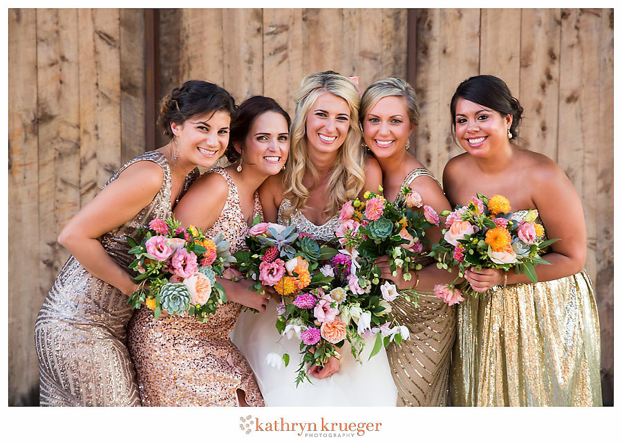 Gold sparkly bridesmaid dresses; bright flowers