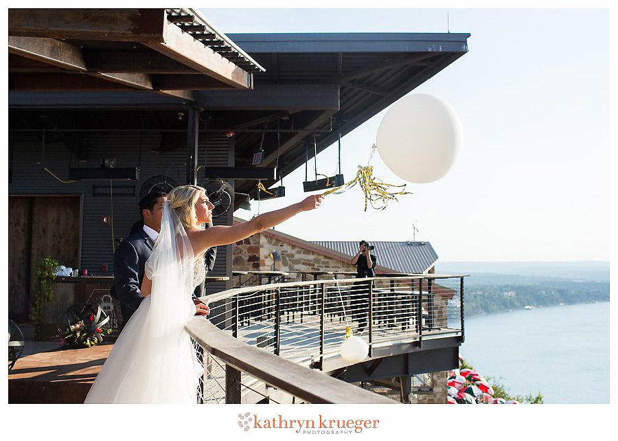 Bride and groom releasing balloons