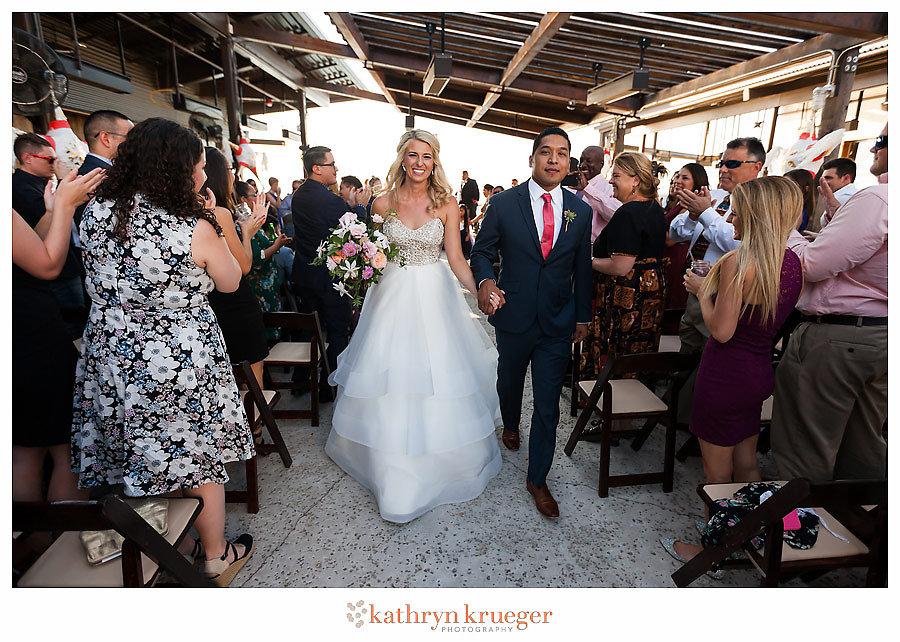 Wedding recessional happy couple