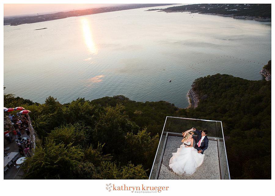 Bride and groom dancing over Lake Travis