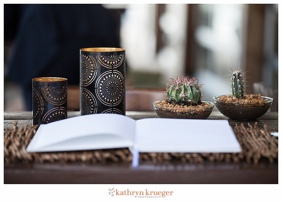 Guestbook table with cacti and tin candleholders