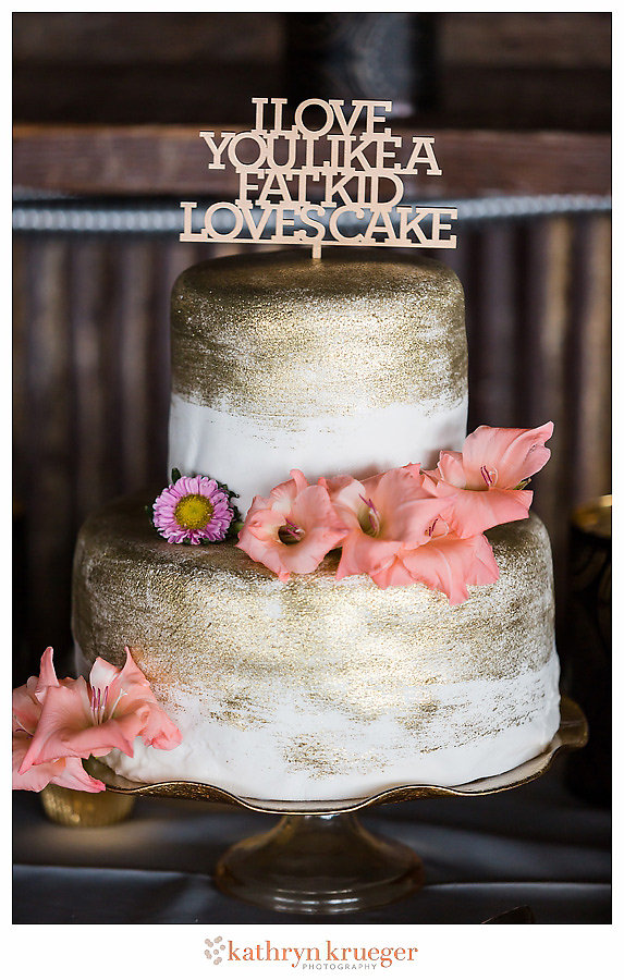 I Love You Like a Fat Kid Loves Cake gold painted wedding cake