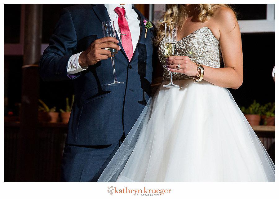 Couple holding toasting flutes